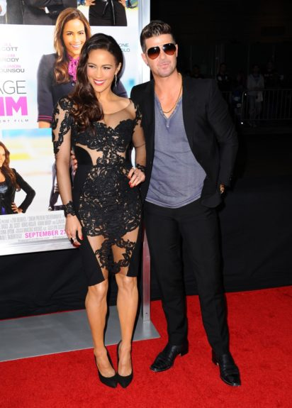 Paula Patton, Robin Thicke arriving at the premiere of<em>Baggage Claim</em>in Los Angeles.