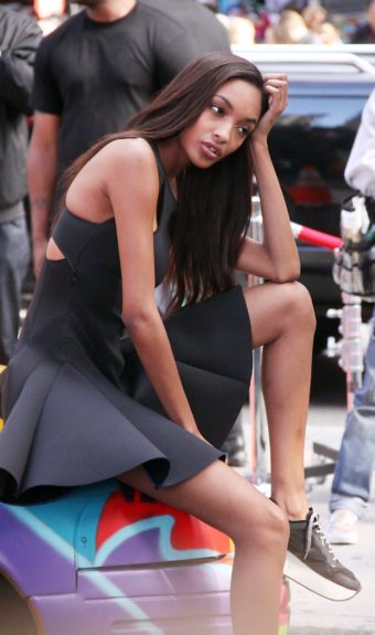 Jourdan Dunn shooting on location for DKNY at Times Square in New York City.