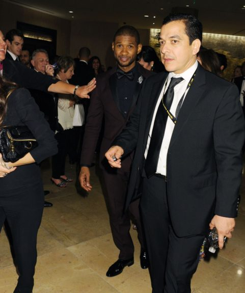 Usher attending the 2014 Golden Globe Awards, held at the Beverly Hilton Hotel in Beverly Hills.