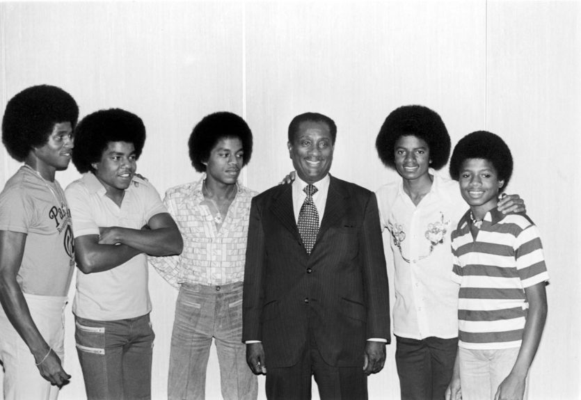 The Jackson 5 pose it up with EBONY founder John H. Johnson