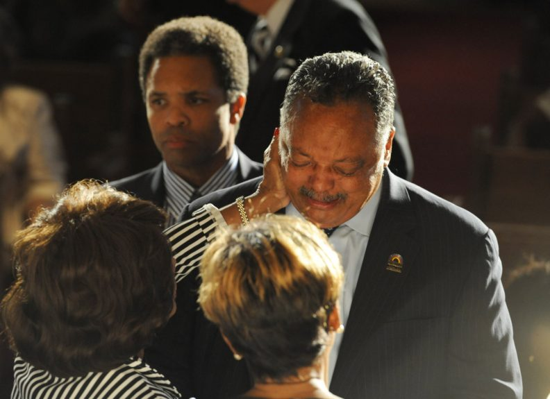 """Rev. Jesse Jackson, flanked by son Jesse Jackson Jr., is overcome with emotion.  <span style=""""color: rgb(0, 0, 0); font-family: Calibri; font-size: medium;"""">Credit: John H. White</span>"""