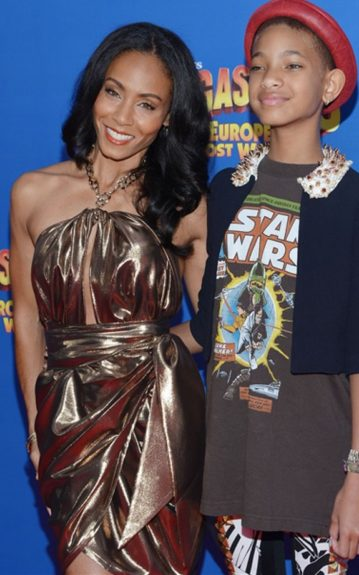 Mother and daughter, Jada and Willow at the <em>Madagascar 3 </em>premiere. Jada channels Greek goddess in a Ferragamo dress. Willow went for playful, donning a <em>Star Wars</em> oversized tee, detailed leggings, spiked collar blazer, and accessorizing with a red brimmed hat