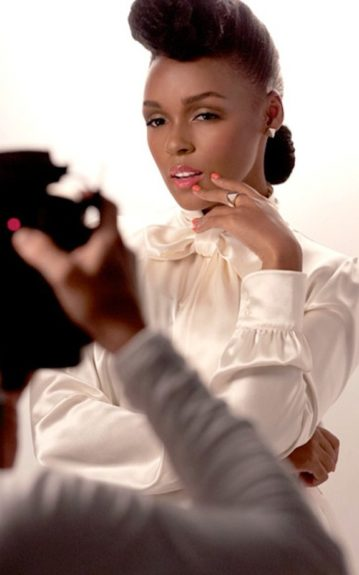 Janelle Monae poses in her signature hairstyle, and a silky white blouse as the new face of CoverGirl. Photo Credit: Janelle Monae's Twitter
