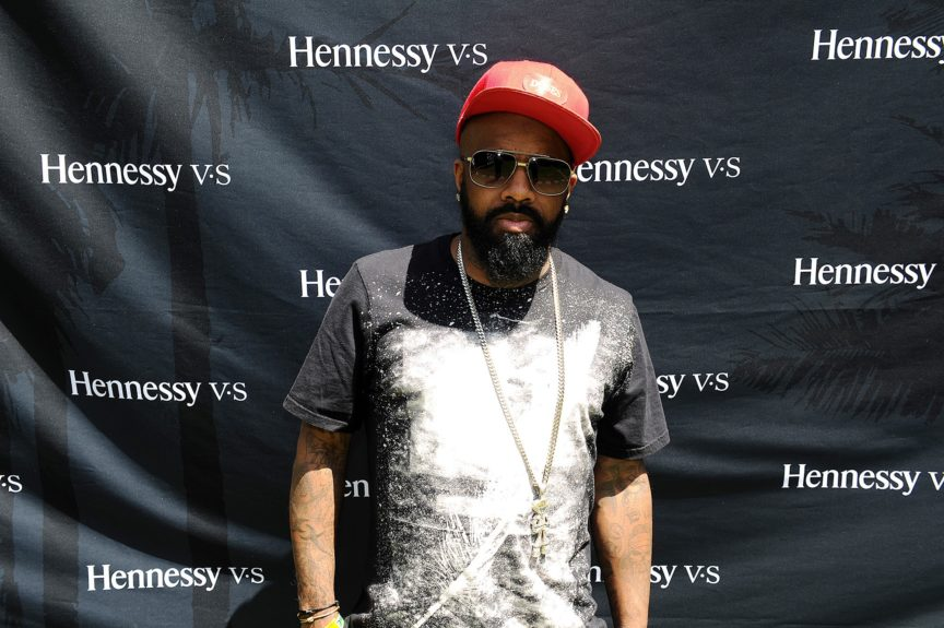 "Jermaine Dupri gets ready to spin on the ones and twos at the Hennessy V.S desert brunch celebrating the 20<sup>th</sup>anniversary of Nas' album ""Illmatic,"" held during Coachella in Palm Springs on April 13."