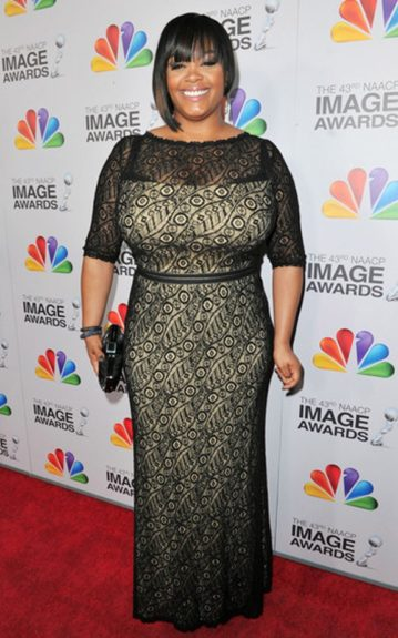 Jill Scott covered up but left much to the imagination in this floor-length dress with a black lace overlay against a neutral lining