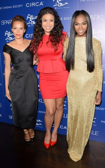 Carmen Ejogo wore a black ankle-length dress, and strappy black pumps next to Jordin in her red Alice + Olivia dress, and pumps; while Tika wore a gold shimmery gown. Photo Credit: INF