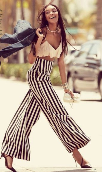 Classy and fabulous, Dunn sports uber chic, wide-leg pants by Chanel with a black and white stripped pattern, silk ruffle cropped top by Miu Miu, a leather Chanel handbag, and black Louboutin pumps. Photo Credit: <em>Allure</em> magazine