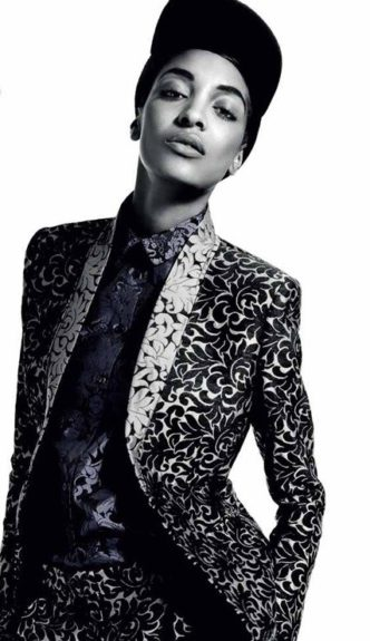 Shooting in Russia in this printed suit by Stella McCartney and hat by Prada, Jourdan shows us her versatility to be androgynous and still be able to deliver a soft frame. Photo Credit: <em>Vogue</em> Russia