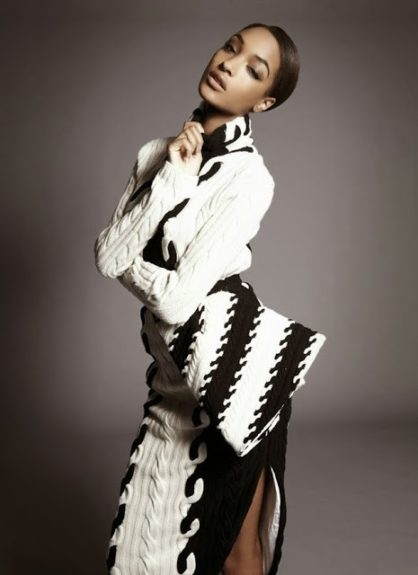 Jourdan gives us a sexy pout in this couture winter number, of a white and black contrasting sweater dress as she posed at a recent cover shoot. Photo Credit: <em>S Moda</em> magazine