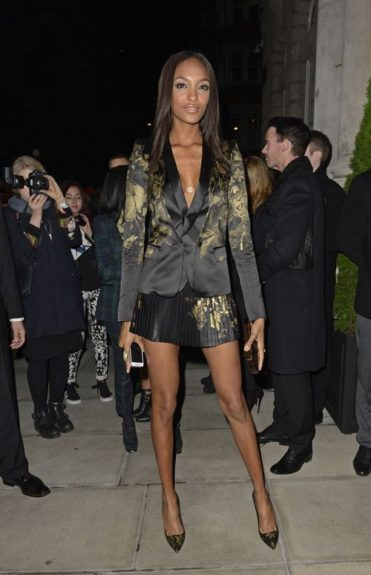 "Jourdan jet-set over to London recently, and got caught looking stunning by the paparazzi in this ""good girl gone bad"" ensemble. She sports a gold and black Roberto Cavalli pleated skirt and blazer, accompanied by matching Cavalli pumps."