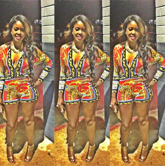 Fiancée to Cam'ron, Juju headed out in Atlanta in an ornate printed romper, Versace necklace, and sexy gold Giuseppe sandals. Such a fun night look. <em>Photo</em>: Juju's Instagram