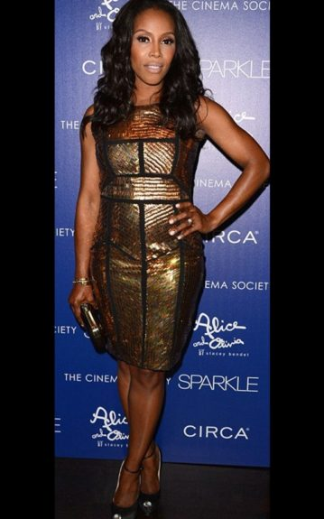 June Ambrose wore a gorgeous gold and black embellished dress by Renzo and Kai, and black peep toe punps. Photo Credit: Getty