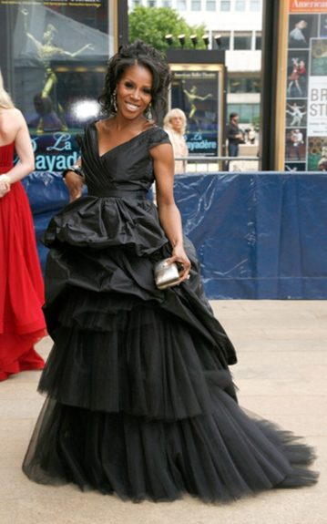 June Ambrose channeled Black Swan in Carlos Miele's fall 2012 black gown with a tiered, tulle train