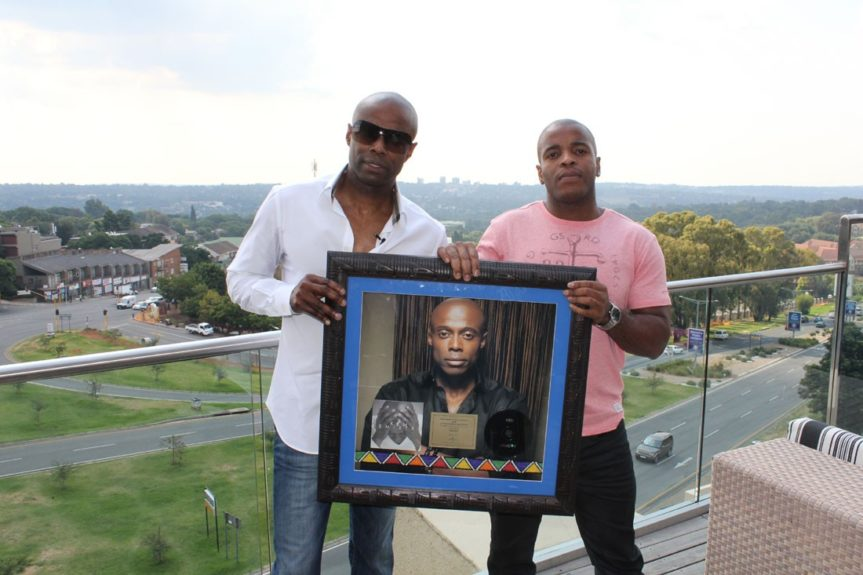 KEM and Motown SA executive Vincent Ntuli hold Gold plaque for 'KEMISTRY' album