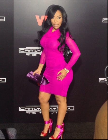 K.Michelle is pretty in pink at the premiere for VH1's <em>Crazy Sexy Cool: The TLC Story</em>, in this berry mesh long sleeve dress by Jean Paul Gaultier.