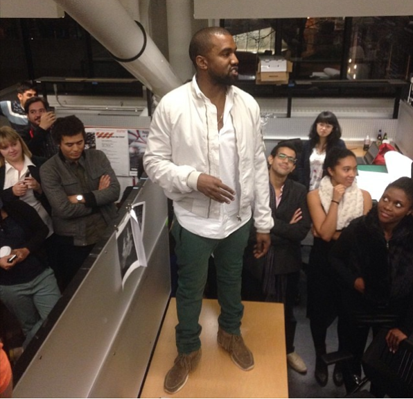 Kanye gives a pep talk to the fashion design students at Harvard in effortless threads. He sported a sold out white bomber by Rick Owens, tailored green trousers, and tan loafers.