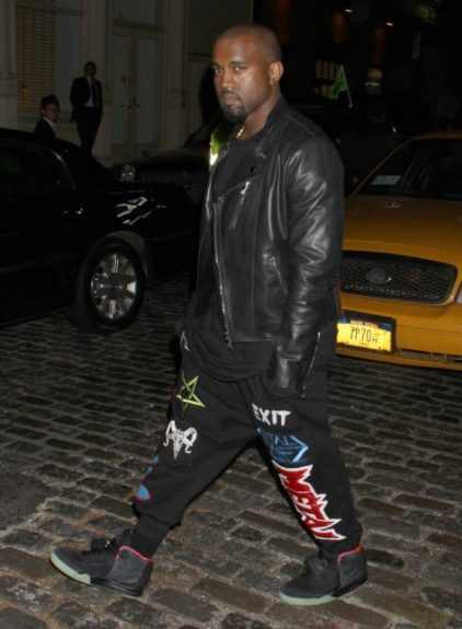 Kanyegrills the paps as he heads out on the town in theseKokontoZaiKTZjogging pants that have also been spotted on Rihanna. West pairs the statement slacks with a simple black t-shirt, leather jacket, and his AirYeezys.