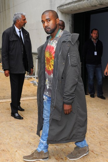 If boho chic is the look Yeezy was going for, we'd say he nailed it in this long grey parka, tie-dyed t-shirt, ripped jeans and fringed moccasins, as he exits Celine's Spring 2014 show in New York.