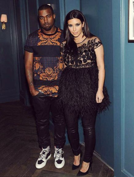 Kanye and Kim pose it up in their matching leather pants, which he pairs with a printed panel 3.1 Phillip Lim shirt, and Balenciaga sneakers, at the Topshop/Topman opening in LA.