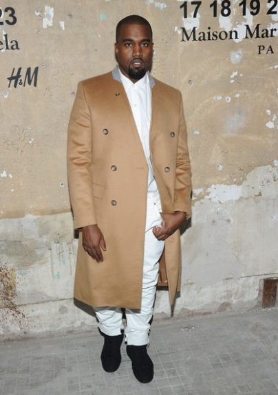 WhenKanyewas in his his more understated, classic phase, he was often seen in basic colors and ensembles and this look is one of our favorites. Handsomely outfitted in a white shirt and pant, West sports a classic tanMargielafor H&M overcoat, which gives us very grow