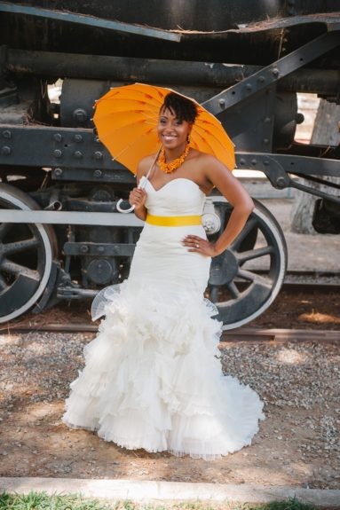 The beautiful bride, Lockell, looks gorgeous in her mermaid gown, accented with a spring yellow waist sash