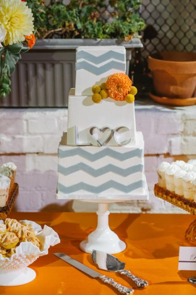 The wedding cake is modern and stylish, just like the wedding party
