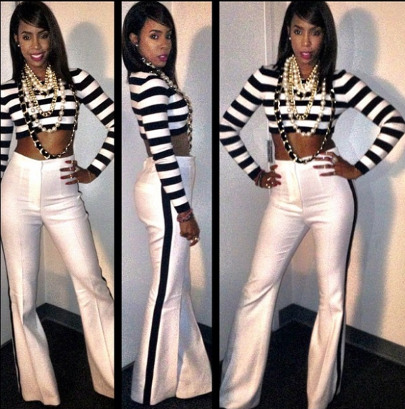Sexy and simplistic Rowland wows in a Michael Korsblack and white cropped top and wide leg trousers. We love that she draped on several necklaces, and added a purple lip for a pop of color.