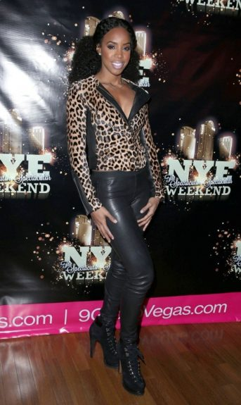 Hanging out in Las Vegas at the Palms Resort, Kelly rocks an A.L.C. leopard fur jacket, leather pants and lace-up Azzedine Alaïa ankle boots.
