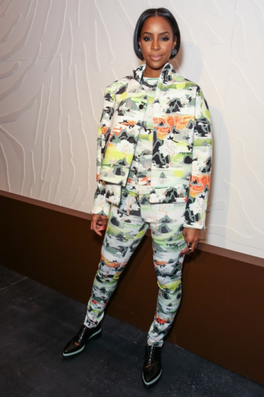 With jet black cropped tresses and printed Opening Ceremony attire from head-to-toe, Rowland hangs out at the 2014 Fashion Show, opening for the brand during New York Fashion Week.