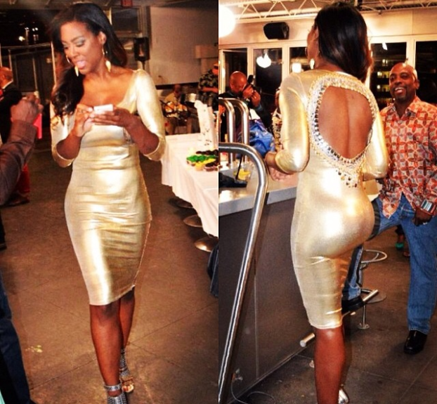 """Miss """"Gone With The Wind Fabulous"""" Kenya Moore, is working all of her curves in this custom metallic gold Siana Treece pencil dress with embellished stone back cutout, during a taping of the new season of <em>The Real Housewives Of Atlanta</em>."""
