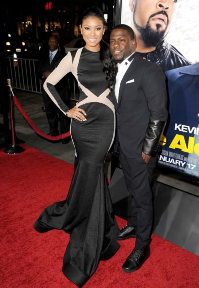 Lovely couple, Kevin and Eniko black out fashion wise at his <em>Ride Along</em> premiere; with her in a sexy Michael Costello gown and him in partial leather sleeve Neil Barrett suit.