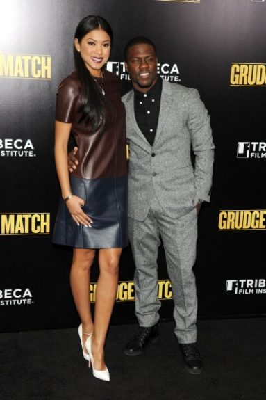 With his beautiful girlfriend by his side, Kevin is very dapper at the premiere of <em>Grudge Match</em>, in this grey and black number. We love the photo chemistry he and Eniko exude!