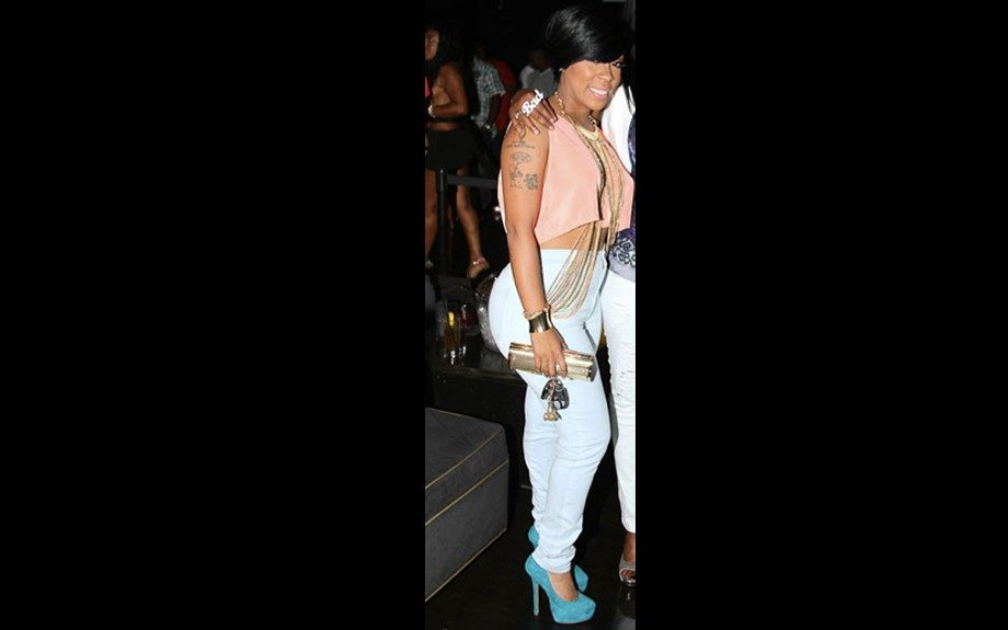 K.Michelle likes to party in her light pink cropped top, powder blue jeans, and teal heels