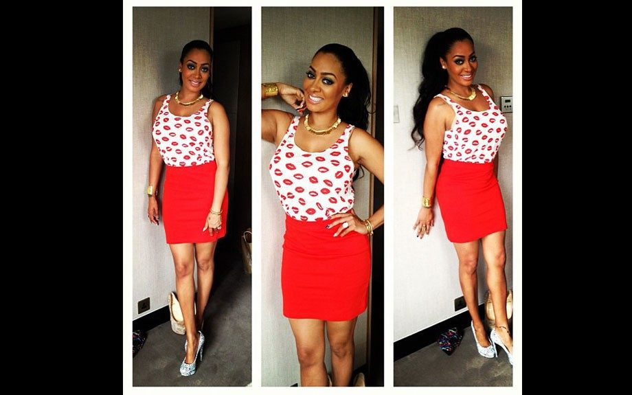 Lala wears a Josaan tank with lip prints, a red Swedish label skirt, and Nicholas Kirkwood x Keith Haring pumps. Photo Credit: Lala's Instagram