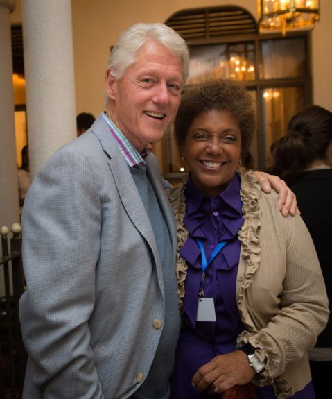 President Clinton and Linda Johnson Rice share a friendly moment on an important global mission