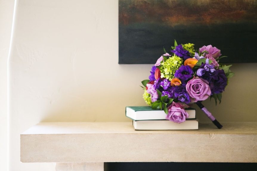 The bouquet is full of soft lilacs and deep violets