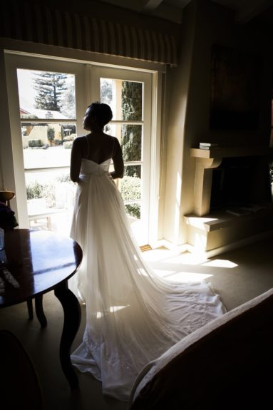 The photographer captures LaWanda in a beautiful moment, just before her wedding