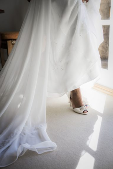 The Shoe: A sexy open toe pump with a sparkling brooch seals the deal on her gorgeous gown