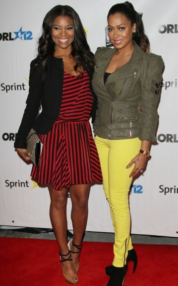 """Alongside her """"Think like a Man"""" co-star, La La Anthony, Gabrielle poses in a pair of colorblock pumps: white heels, black criss-cross straps and a camel strap across the toe"""