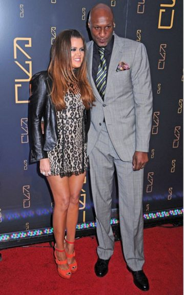 Lamar Odom wore a grey suit with a black collared shirt, a striped tie and colorful pocket square. Don't you think his fashionista in-laws could've helped him out a bit more with his choice of outfit?