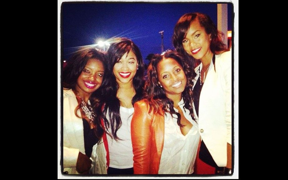 LeToya Luckett wears a popular Helmut Lang blazer with a black shirt, Keisha wears a red jacket and white blouse, Trina wears a white top, Arian wears a white jacket and black top