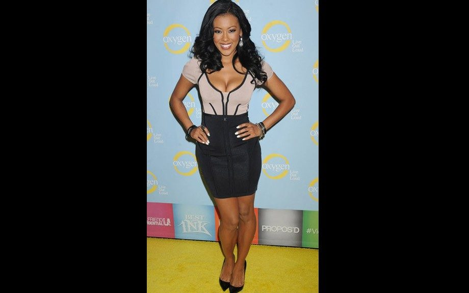 Denyce Laughton rocks a low cut bandage dress with black and silver accessories.