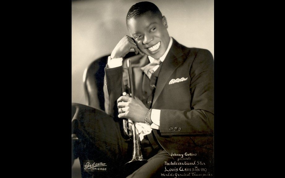 Armstrong's gravely voice and toothy grin were trademarks that served his longstanding career well.