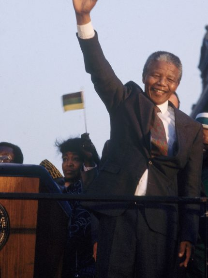 """Nelson Mandela waves to the crowd during a political event in this undated photo. (Moneta Sleet, Jr./Ebony Collection)  View the entire EBONY Collection<strong><a href=""""http://www.ebony.com/store#axzz2PsEj7sec"""" target=""""_blank"""">here</a></strong>."""