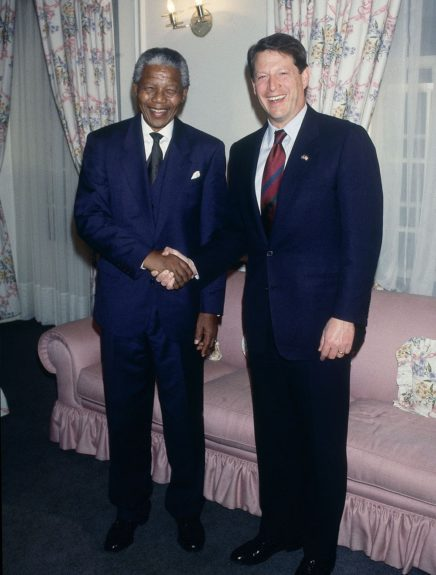 """Nelson Mandela shakes hands with politician Al Gore in this undated photo. (Moneta Sleet, Jr./Ebony Collection)  View the entire EBONY Collection<strong><a href=""""http://www.ebony.com/store#axzz2PsEj7sec"""" target=""""_blank"""">here</a></strong>."""