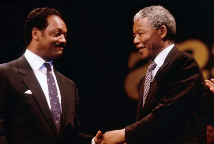 """Nelson Mandela shakes hands with Rev. Jesse Jackson, Sr. in this 1990 photo. (Frederick Watkins, Jr./Ebony Collection)  View the entire EBONY Collection<strong><a href=""""http://www.ebony.com/store#axzz2PsEj7sec"""" target=""""_blank"""">here</a></strong>."""