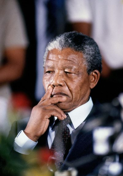 """Nelson Mandela is pictured in deep thought in this 1990 photo. (D. Michael Cheers/Ebony Collection)  View the entire EBONY Collection<strong><a href=""""http://www.ebony.com/store#axzz2PsEj7sec"""" target=""""_blank"""">here</a></strong>."""
