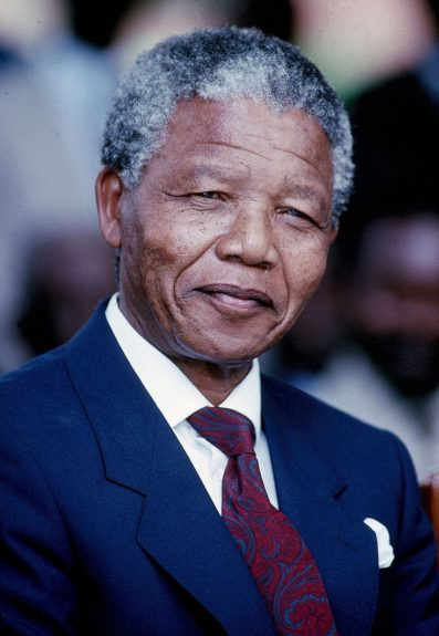 """Nelson Mandela smiles in this 1990 photo. (D. Michael Cheers/Ebony Collection)  View the entire EBONY Collection<strong><a href=""""http://www.ebony.com/store#axzz2PsEj7sec"""" target=""""_blank"""">here</a></strong>."""