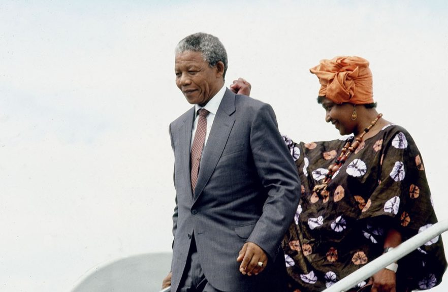 """Nelson Mandela addresses the crowd with his wife Winnie in this 1990 photo. (Frederick Watkins, Jr./Ebony Collection)  View the entire EBONY Collection<strong><a href=""""http://www.ebony.com/store#axzz2PsEj7sec"""" target=""""_blank"""">here</a></strong>."""