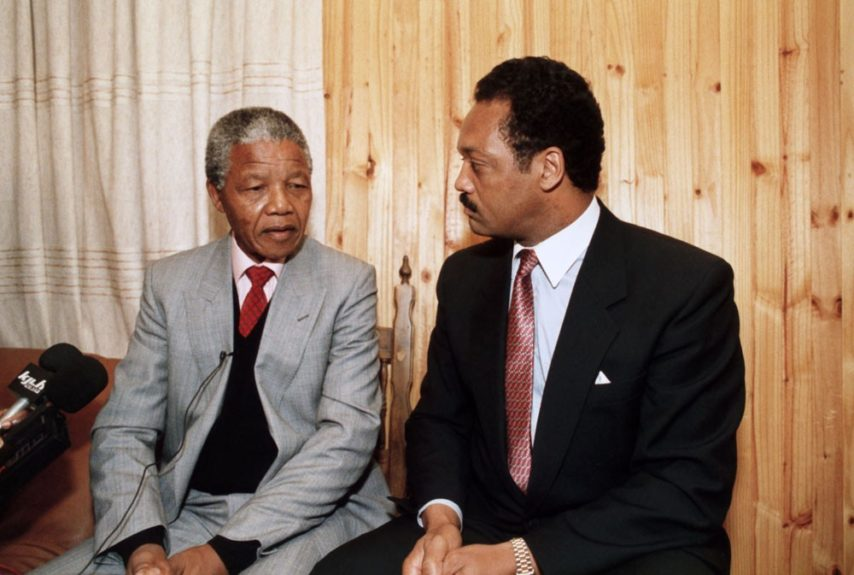 """Nelson Mandela sits for an interview alongside Rev. Jesse Jackson during his United States tour in 1990. (D. Michael Cheers/Ebony Collection)  View the entire EBONY Collection<strong><a href=""""http://www.ebony.com/store#axzz2PsEj7sec"""" target=""""_blank"""">here</a></strong>.<"""